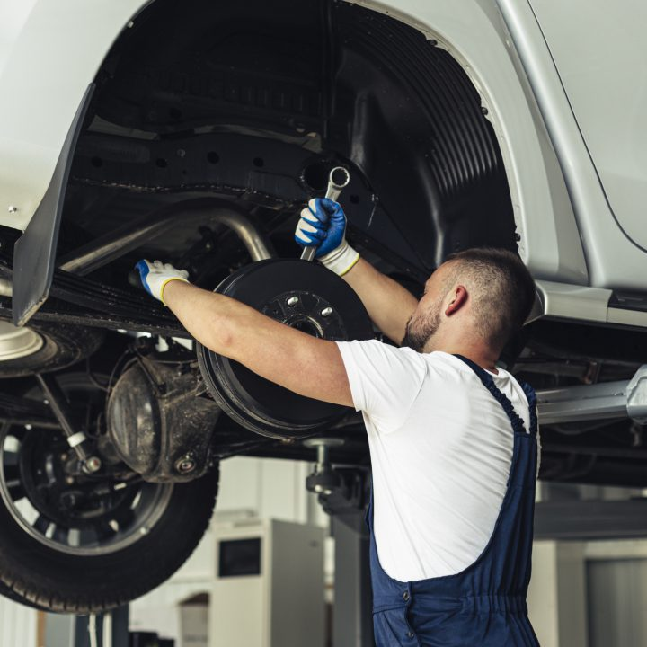 a man repairing a car
